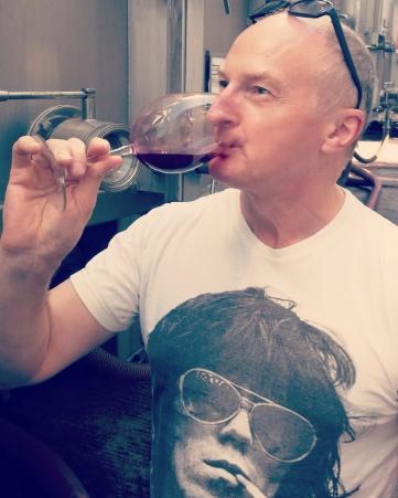 The Sahib drinking red wine